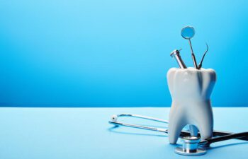 Image of Dental Tools on a Blue Background.